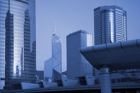 Tall High Rise Urban Office Buildings In Hong Kong, China - Blue Toning Stock Photo