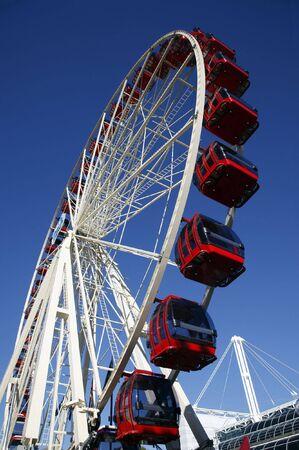 Red Ferris Wheel, Clear Blue Sky, Amusement Park Stock Photo