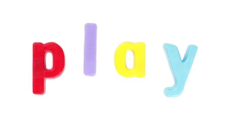 Play - Colourful Fridge Magnets On A White Background Stock Photo