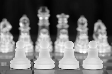 White Chess Pawn, Pieces On Chessboard, Focus On Front Row Stock Photo