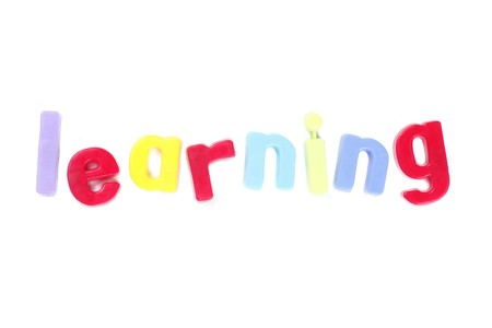 Learning - Word in Colourful Letters On White Background