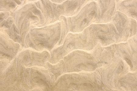 strand zand achtergrond. Zandpatroon Stockfoto