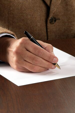 business man signing contract Stock Photo - 10512421