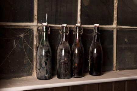 dilapidated: vintage bottle still life