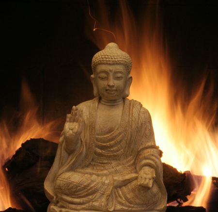 Buddha in front of fire Banco de Imagens