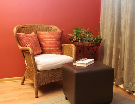 Wicker chair and ottoman provide a nice place to sit and read