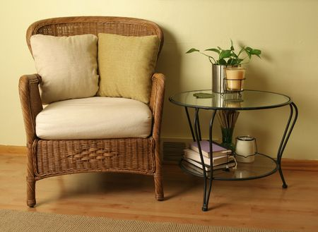 desk area: Wicker chair with glass table Stock Photo