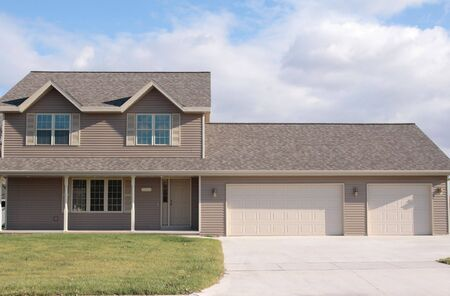 New home with porch and three car garage