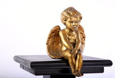 Golden angel on a pedestal