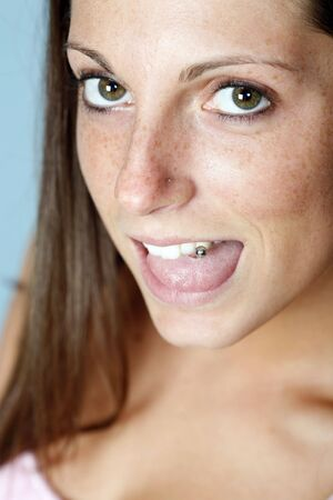 Playful pierced tongue photo