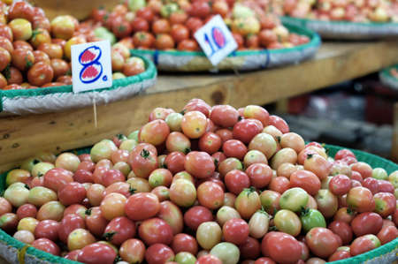 Basket of tomato in the market. photo
