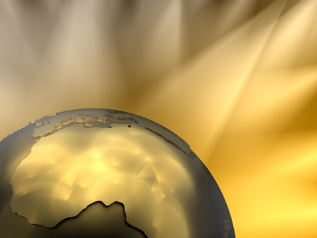 visible: Gold globe close-up - Africa, visible spotlights in background