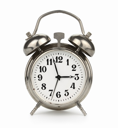plated: Silver plated old alarm clock, isolated on white background Stock Photo