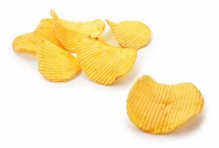 crisps: Golden potato chips on white background Stock Photo