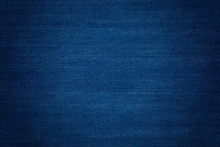 Dark blue denim background, detailed texture with vignette Zdjęcie Seryjne