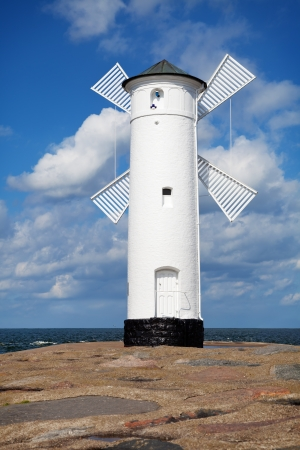 White old lighthouse windmill in Swinoujscie, Baltic Sea, Poland Stock Photo - 14655701