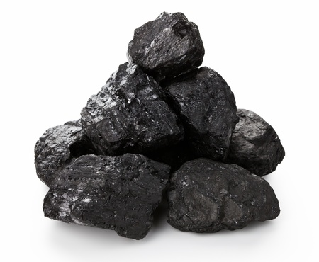 Stack of coal lumps isolated on white background