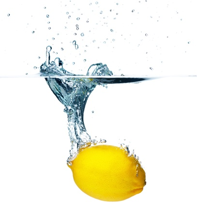 Fresh lemon falling into water  Isolated on white background Stock Photo