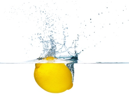 lemon water: Fresh lemon falling into water  Isolated on white background Stock Photo