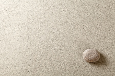 zen spa: Beige stone at right side of sand background