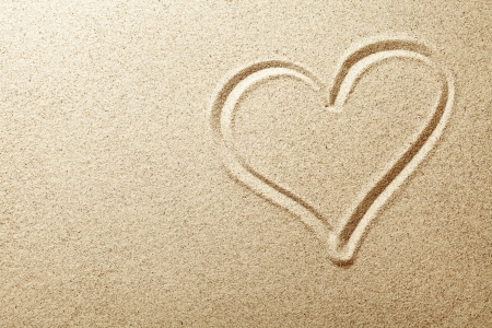 sand grains: Heart drawn in the sand  Beach background  Top view Stock Photo