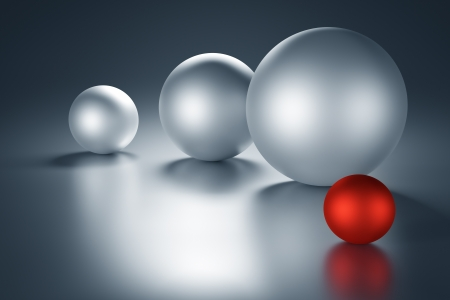 Red metal ball next to other metal balls with copy space. 3d render photo