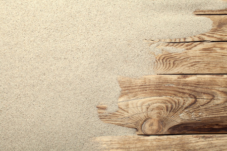 in the sand: Sand on planked wood. Summer background with copy space. Top view