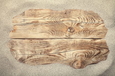 Sand on planked wood for summer. Copy space. Top view Standard-Bild