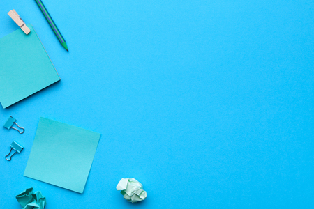 School, office accessories on blue background. Minimal style. Flat lay. Copy space. Top view