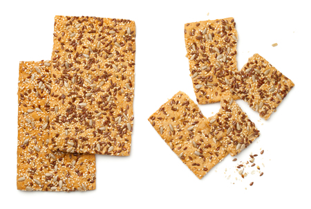 Crisp bread with linseed, sesame and sunflower seed isolated on white background. Top view 스톡 콘텐츠