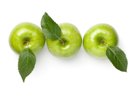 Green apples with leaves isolated on white background. Fresh granny smith apple. Top view, flat lay Stock Photo