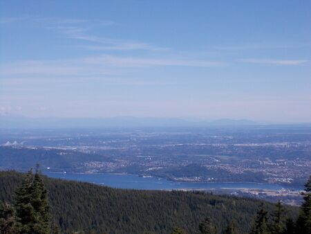 View of Distant Vancouver from top of Grouse Mountain Stock Photo