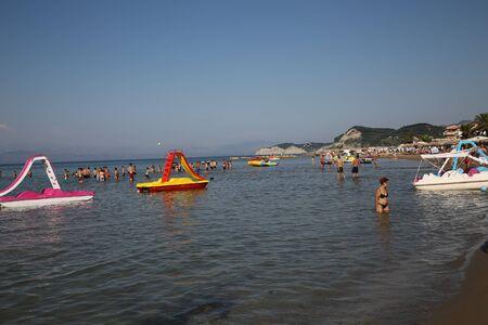 CORFU, GREECE - JULY, 23, 2016: Young people at Sidari beach Editorial