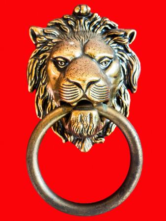 Bronze Lion Door Knocker On Red Background Stock Photo   65375622