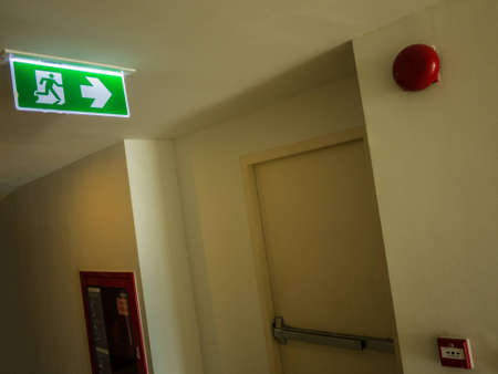 evacuate: Fire exit light sign and symbol (fire) Stock Photo