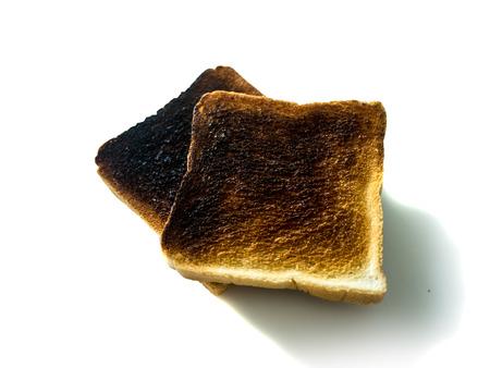 burnt toast: Burnt toast on white background