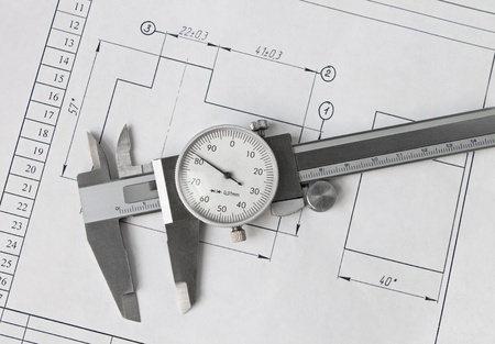 Caliper resting on drawing photo