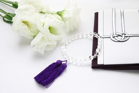 unhappiness: Rosary, unhappiness bag, Lisianthus Stock Photo