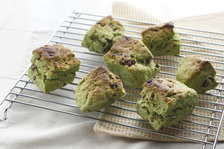 Homemade scone with green tea and chocolate chips.