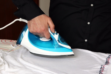 household tasks: Ironing the t-shirt