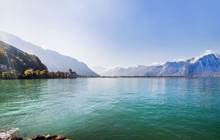 Panoramic view of Geneva lake and Chillion castle among mountains in  Switzerland Editorial
