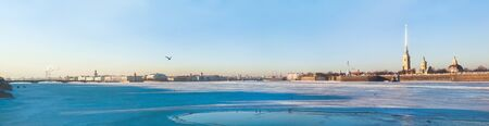 saint petersburg: Panoramic view of Neva river in winter on sunny day in Saint Petersburg, Russia