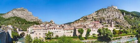 Panoramic view on town Entrevaux, France. Mountains and old fortification castle.