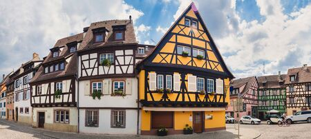 half  timbered: Panoramic view on old street with half timbered houses in Colmar, France.