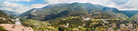 Panoramic view on town Entrevaux, France. Mountains and blue river. photo