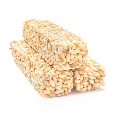 puffed: Puffed rice crispies isolated on white background