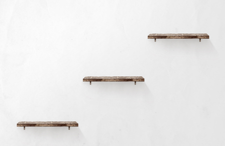three shelves: Three empty wooden shelves on the wall