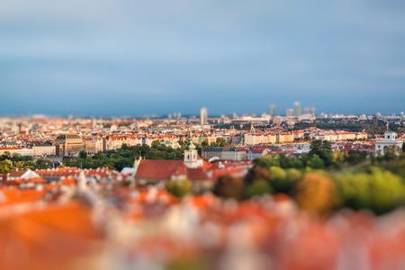 Aerial view of Prague, Czech Republic on a sunny evening. Miniature tilt shift lens effect.