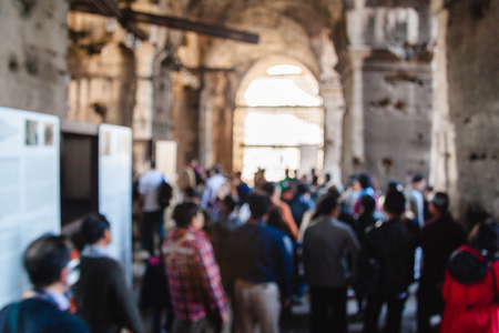Blurred unfocused picture of tourists in Coliseum. Rome. Italy Stock Photo - 83717571