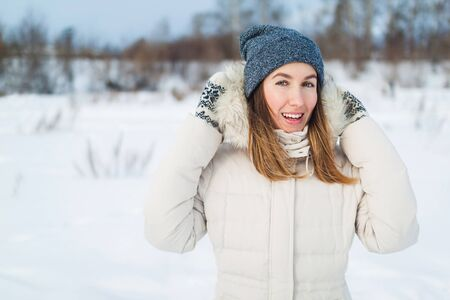 Christmas girl outdoor portrait. Woman in winter clothes on a snow field. Stock Photo - 83717588